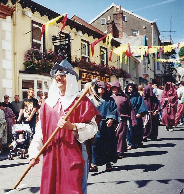Monks in the Pilton Festival Parade in front of The Chichester Arms in 2001