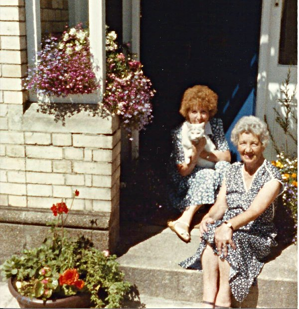 Phyllis Allen and Connie Barnes on the doorstep of 123 Pilton Street, Pilton
