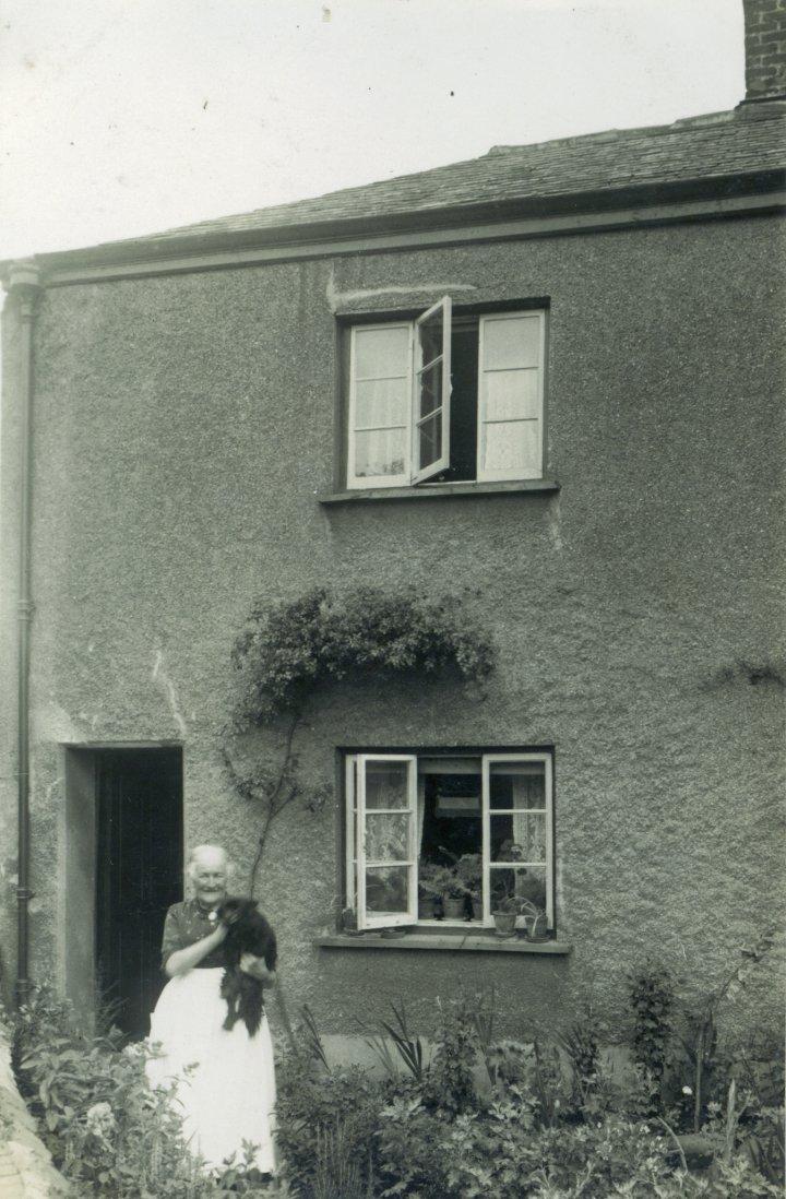 Jane Bartlett outside No 8 Pilton Quay with 'Darkie' the Pomeranian