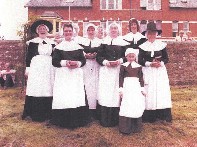 Pilton Women's Institute at Pilton Festival as Puritans probably in 1982