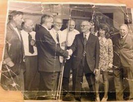 Mr Frank Pert receives a fishing rod and gold pen on retirement from the North Devon Journal Herald in 1976