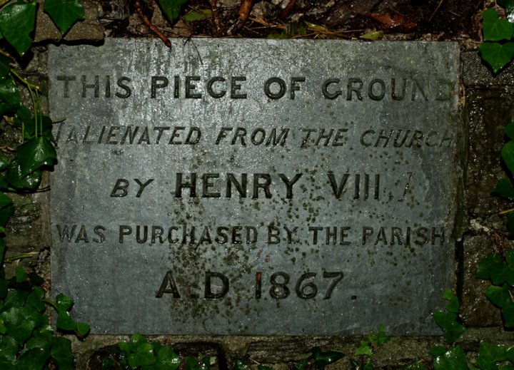 Plaque concerning church land taken by Henry VIII on the Dissolution of the Monasteries