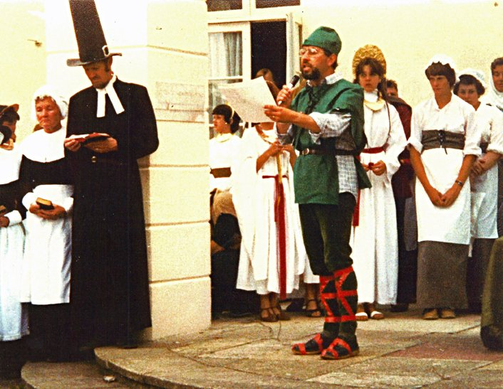 Rev Anthony Geering proclaiming at the first Pilton Festival in 1982